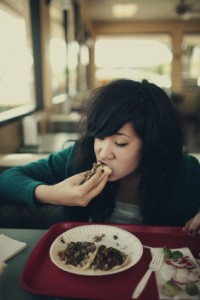 photo of an asian eating a taco