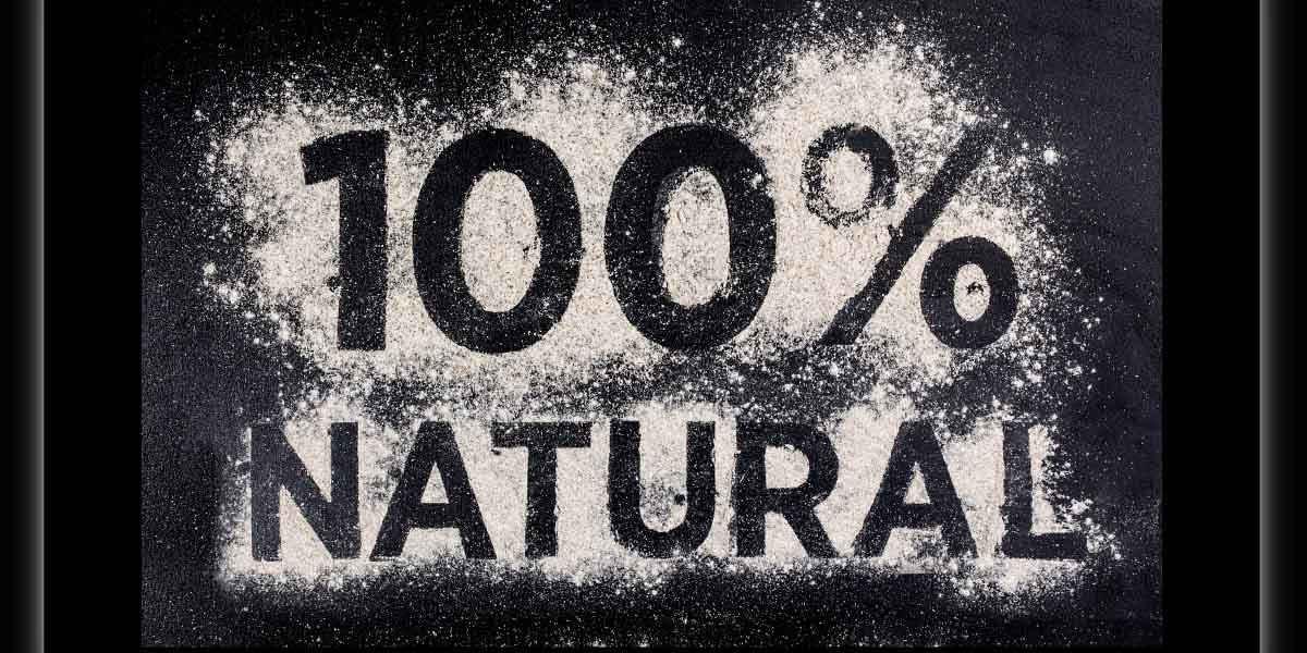 100 percent natural, gluten free food, word made of flour, table wooden background.